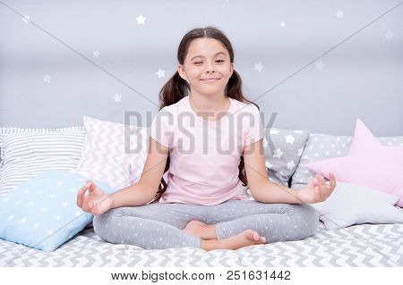 Meditate Before Go To Bed. Girl Child Sit On Bed In Her Bedroom. Kid Prepare To Go To Bed. Pleasant