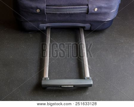 close up baggage case handle grip on a dark surface poster