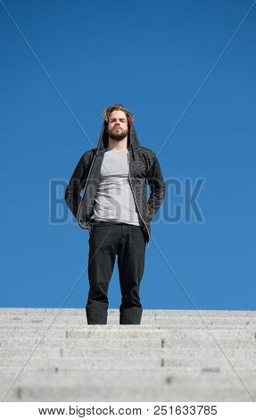 Reach Out For Top. Man Handsome Guy Enjoy Morning Walk On Stairs Blue Sky Background. Morning Fill E