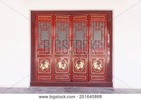 Gateway With Red Chinese Doors At Kunming , China