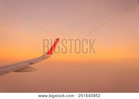 Wing Of Airplane Flying On Beautiful Sky.