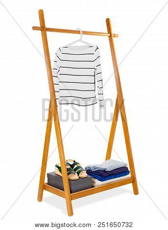 Wooden clothes rack with white woman sweater on clothes hangers and Leather shoes with accessory fas