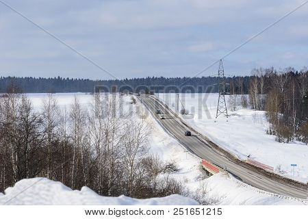 Highway In Winter Among The Fields. Snowfields