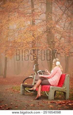 Woodland Nature Relax Cozy Fitness Internet Technology Concept. Lady With Tablet In Park. Young Blon