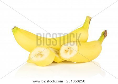 Group Of One Whole One Half Three Slices Of Fresh Yellow Banana Isolated On White Background