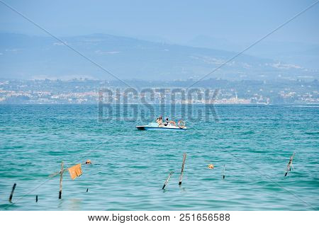 Sirmione, Italy - July 23, 2018: Public Beach At Garda Lake On A Beautiful Summer Day With Tourists