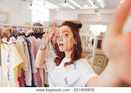 Blogger And Selfie. Stylish Beautiful Fashion Blogger Making Selfie While Standing In Shopping Mall