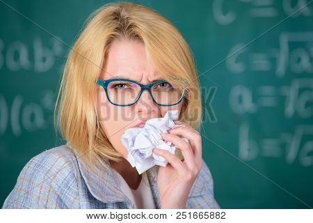 Teacher ready to eat her paperwork. Teacher eats piece of paper absorb information. Thirst of knowledge. Woman teacher eats crumpled piece of paper chalkboard background. Hungry for knowledge. poster