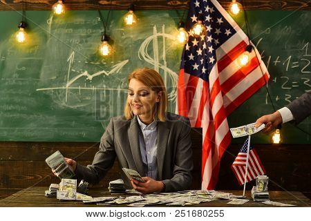 Economy And Finance. Economy Concept With Woman Giving Money To Man