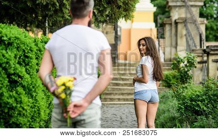 How To Pick Up Girl. Girl Looks At Man With Bouquet With Interest. Start Dating. Golden Rules For As