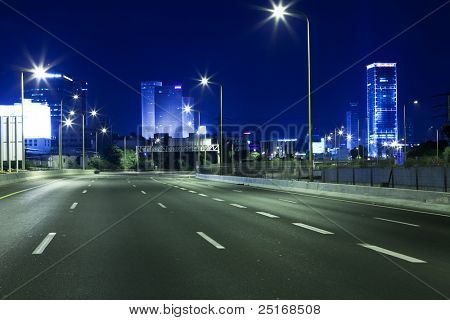 Empty freeway at night poster