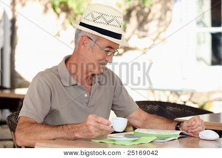 Older man at an alfresco cafe