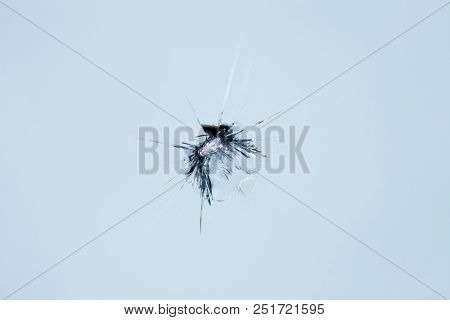 Closeup of cracked windshield with fissure lines, abstract background with copy space poster