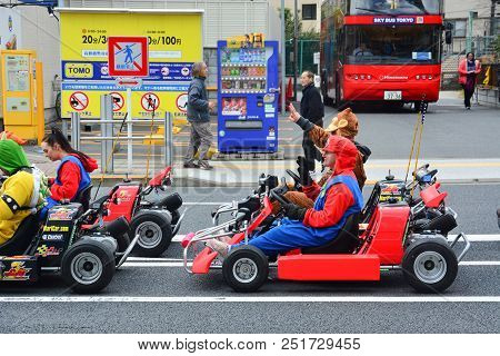 Tokyo, Japan - March 7, 2018 : Street Kart Tour, Mario Kart Tour Is Tourists Dress Up In Superhero C