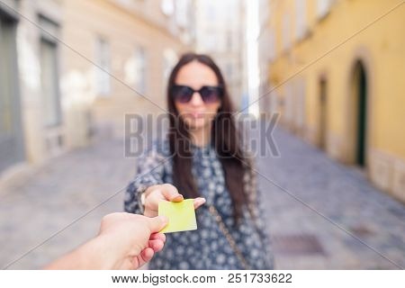Closeup Shot Of A Woman Passing A Payment Credit Card. Girl Holding A Credit Card. Shallow Depth Of