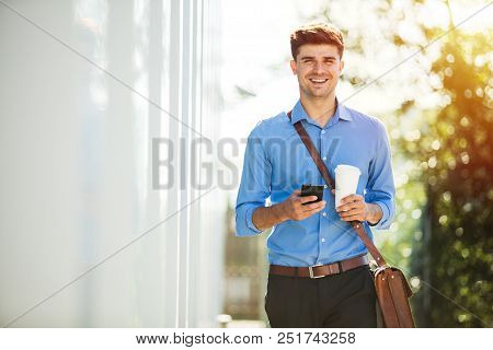 Young Office Man With Coffee Cup Outside
