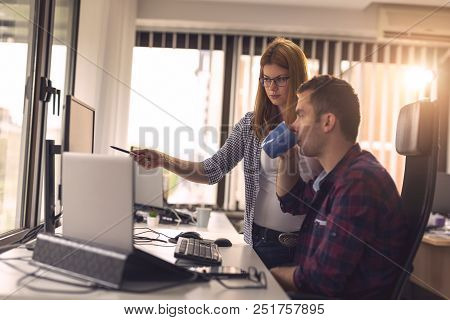 Two Software Developers Working On A New Project In A Software Developing Company Office. Focus On T