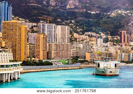 Monaco, Monte Carlo Cityscape. Real Estate Architecture On Mountain Hill Background. Many High-rise