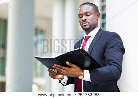 Black businessman reading his agenda