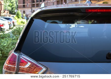 Back Window Of A Car Parked On The Street In Summer Sunny Day, Rear View. Mock-up For Sticker Or Dec