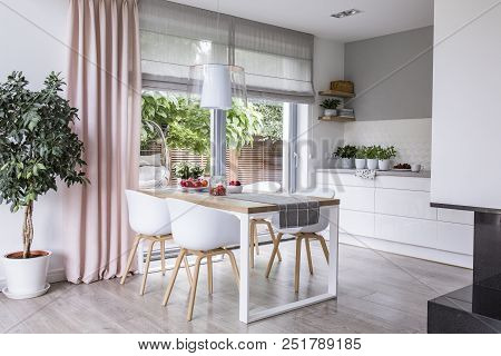 Gray Roman Shades And A Pink Curtain On Big, Glass Windows In A Modern Kitchen And Dining Room Inter