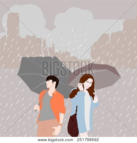 Man With Umbrella And Women With Umbrella On Rainy Season In The City.