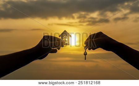 Hand Transfers The Key For The House. Concept Of Selling Real Estate.