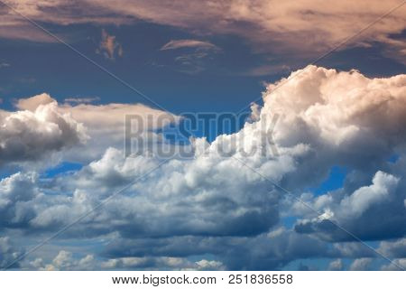 Clouds Of Heaven At Sunset. The Background Of The Cloudy Sky.