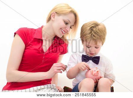 Bank Advertising. Safety Money Concept. Little Boy Put Coin In Piggy Bank. Boy Holding Money Box. Sa
