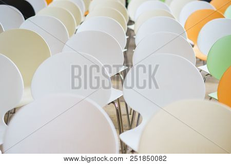Rows Of Several Plastic Chairs In An Empty Audience. Training, Seminars And Meetings. Preparation Of