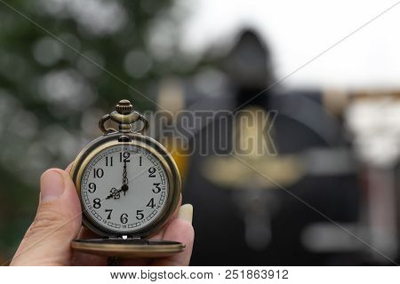 Clock With Lid Shows At 8 O'clock On Steam Locomotives Blurred