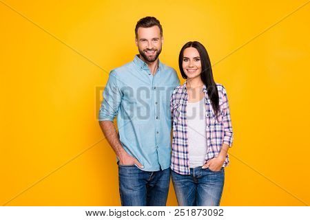 Portrait Of Attractive Stylish Couple Hugging Holding Hands In Pocket Of Pants Looking At Camera Iso