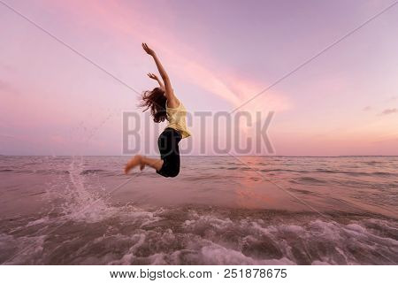 Asian Pretty Woman  Is Jumping And Relax On Beach. Positive Emotions. Summer Concept.
