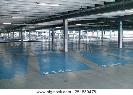 Empty Modern Multilevel Parking Garage Building With Numbered Parking Spaces