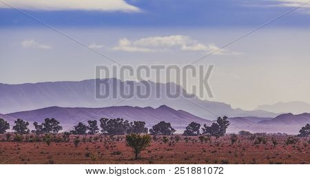 Silhouettes Of Flinders Ranges Mountain Range In Early Morning Mist In South Australia