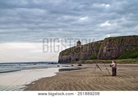Fishermen On Benone Beach Near The Mussenden Temple