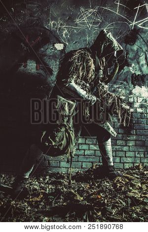 Nuclear Post-apocalypse Survivor In Gas Mask And Ghillie Cape, Sneaking In Deep Underground Tunnel O