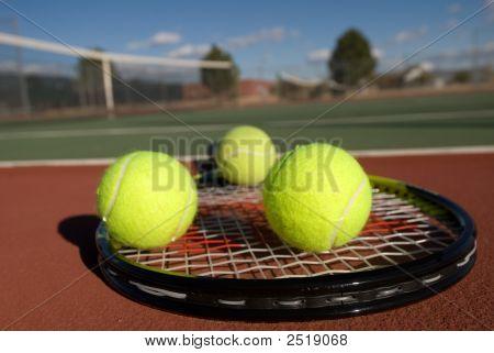 Tennis Balls, Court And Racquet
