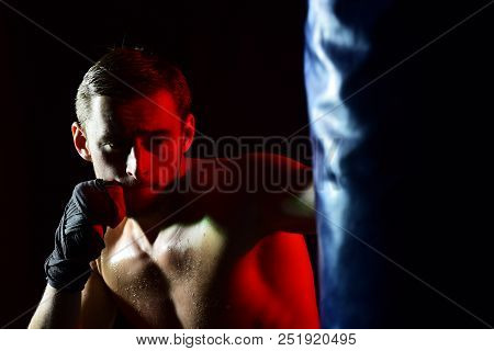 Training Concept. Man Boxer Training In Gym. Sportsman Punch Training Bag. Training Hard Or Go Home