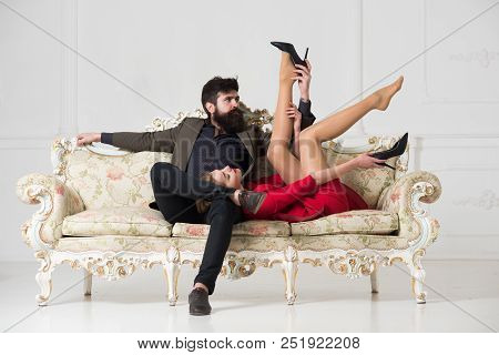Physiotherapist. Man Physiotherapist Makes Massage For Woman. Physiotherapist And Woman Client. Leg
