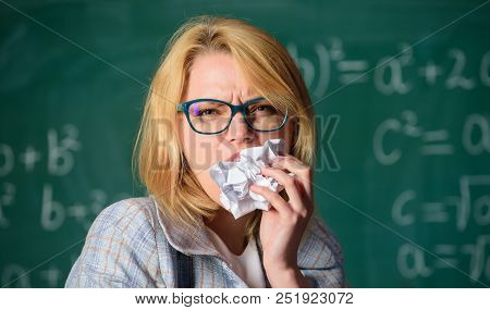 Thirst of knowledge. Hungry for knowledge. She ready to eat her paperwork. Teacher eats piece of paper with mistake failed test. Woman teacher eats crumpled piece of paper chalkboard background. poster