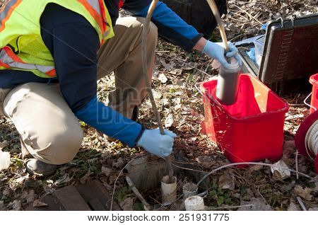 Scientific Geochemical Ground Water Sampling Outdoors - Canada