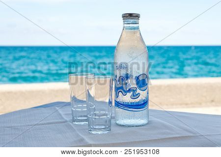 Bottle Of Cold Water With Text Inscription H2o