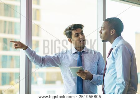 Sales Manager And Investor Discussing Construction Out Window. Indian Man In Formal Tie With Tablet