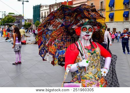 MEXICO CITY,MEXICO - JULY 12,2018 : Mexican woman wearing a colorful Catrina costume in Mexico City