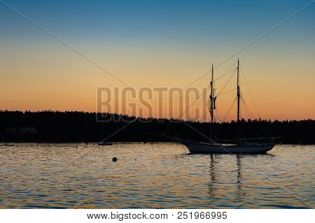 Sailboat In Sunset Silhouette - Maine, Usa