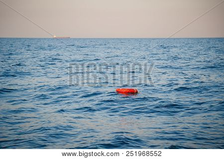Safety Equipment, Life Buoy Or Rescue Buoy Ring With A Rope Floating In Blue Sea To Rescue People. Y