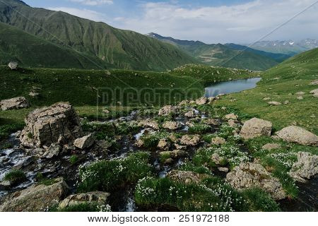 Landscape Of The Abudelauri Lake Near The Chaukhi Mountain Range In Georgia. Mountain Range At The B