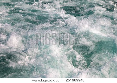 Surface Water Waves Texture, White Foam Of Sea Water Waves Background.