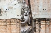 Big Buddha at Wat Si ChumIt Sukhothai Thailand Big Buddha Width of 11.30 meters, 15 meters high, is the art of Sukhothai. Built from the Sukhothai period The place is a tourist attraction of Thailand. poster